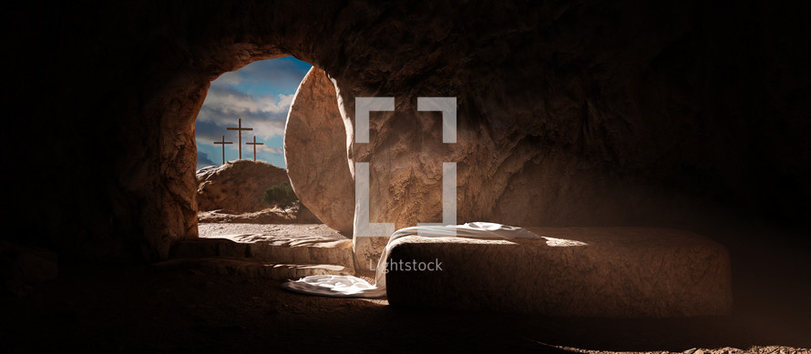 Empty tomb of Jesus with crosses in the background