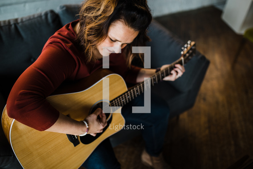 a woman playing a guitar