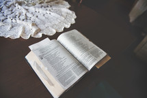 open Bible and lace cloth on a table