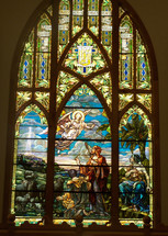 An Angel appears before a group of Shepherds in this stained glass window art depiction of the coming Jesus and announcing HIs birth. 