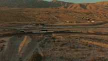aerial view over traffic on a highway and a train on the tracks in Palm Springs
