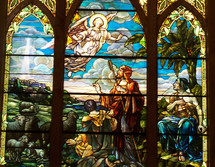 """An Angel appears before a group of Shepherds in this stained glass window art depiction of the coming Jesus and announcing HIs birth.   """"And there were shepherds living out in the fields nearby, keeping watch over their flocks at night.  An angel of the Lord appeared to them, and the glory of the Lord shone around them, and they were terrified. But the angel said to them, """"Do not be afraid. I bring you good news that will cause great joy for all the people. Today in the town of David a Savior has been born to you; he is the Messiah, the Lord. This will be a sign to you: You will find a baby wrapped in cloths and lying in a manger."""" - Luke 2: 8 - 12"""