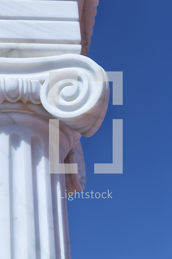 white column against a blue sky