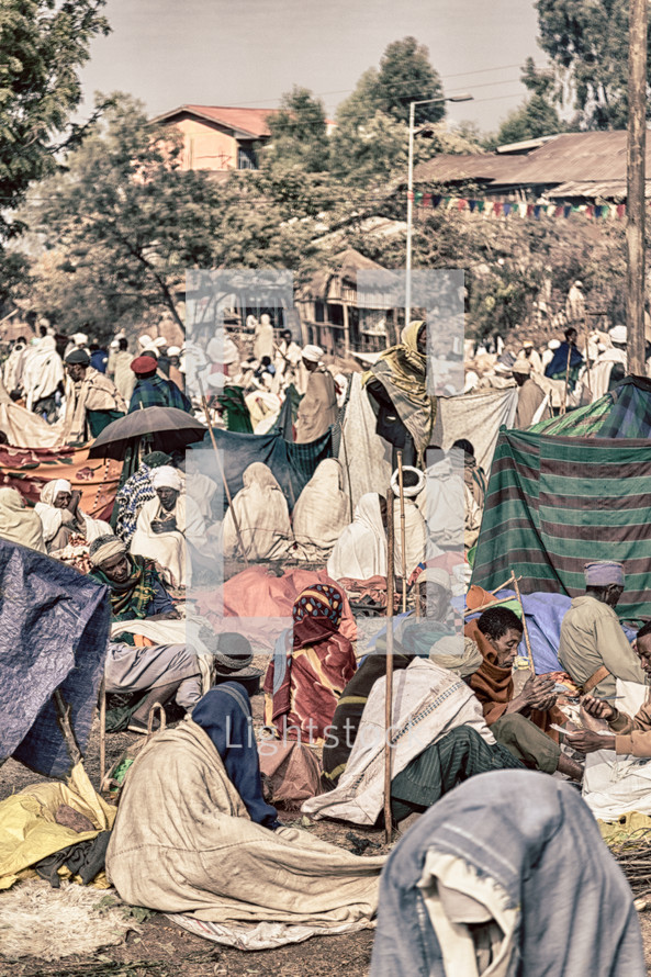 crowds of people in tents gathered for a celebration in Ethiopia