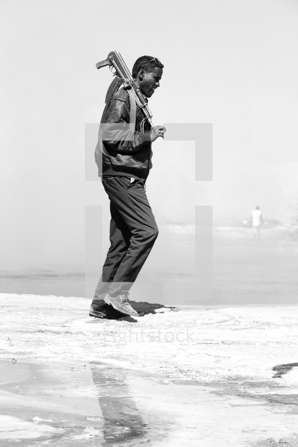 man policing the area near a salt lake in Ethiopia