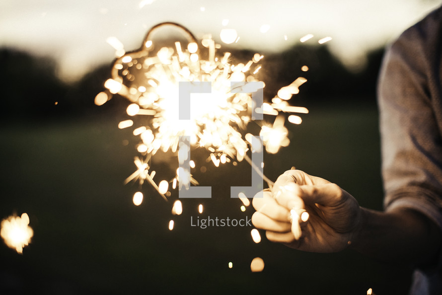 hand holding out a sparkler