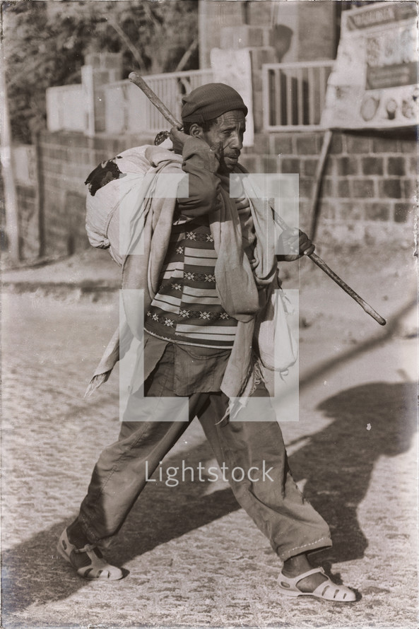 man walking carrying clothes in Ethiopia