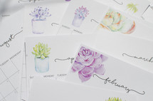 calendar pages with succulent plants