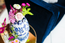 pink flowers in a blue and white porcelain vase