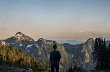 A man standing on mount rainier