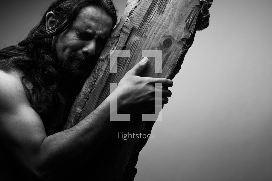 The suffering of Christ -- Jesus crying in pain as he carries the cross.