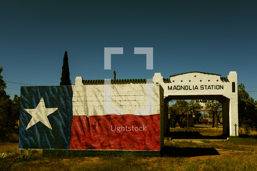 Texas flag mural on an abandoned gas station.