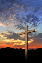 Wooden cross at sunset.