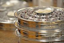 Silver communion trays.