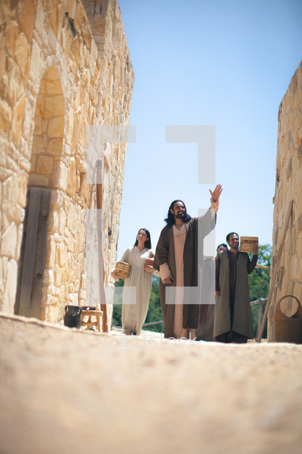 woman at the well - Jesus and his disciples walk through town
