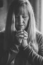 Woman praying.