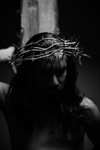 The suffering of Christ -- Jesus wearing His crown of thorns as he carries the cross.