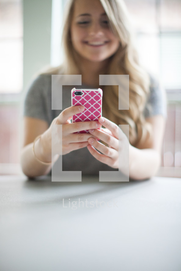 woman looking at her cellphone screen