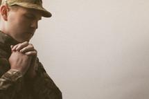 soldier in prayer