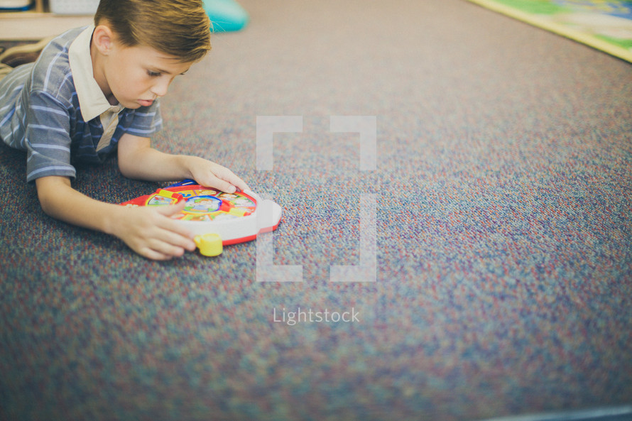 boy playing with a toy in the church nursery