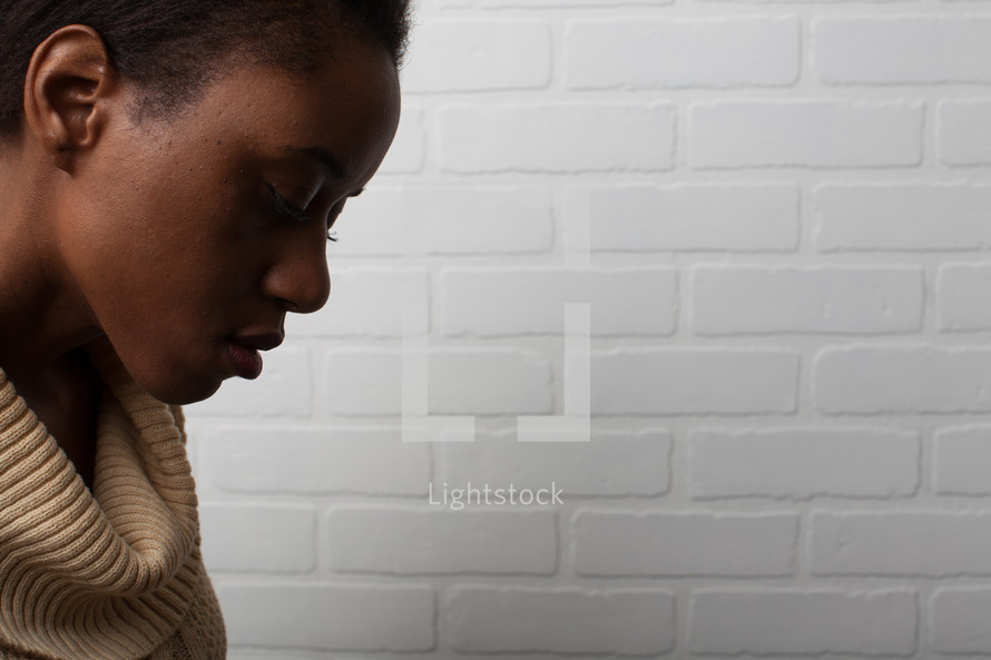 face of an African-American looking down