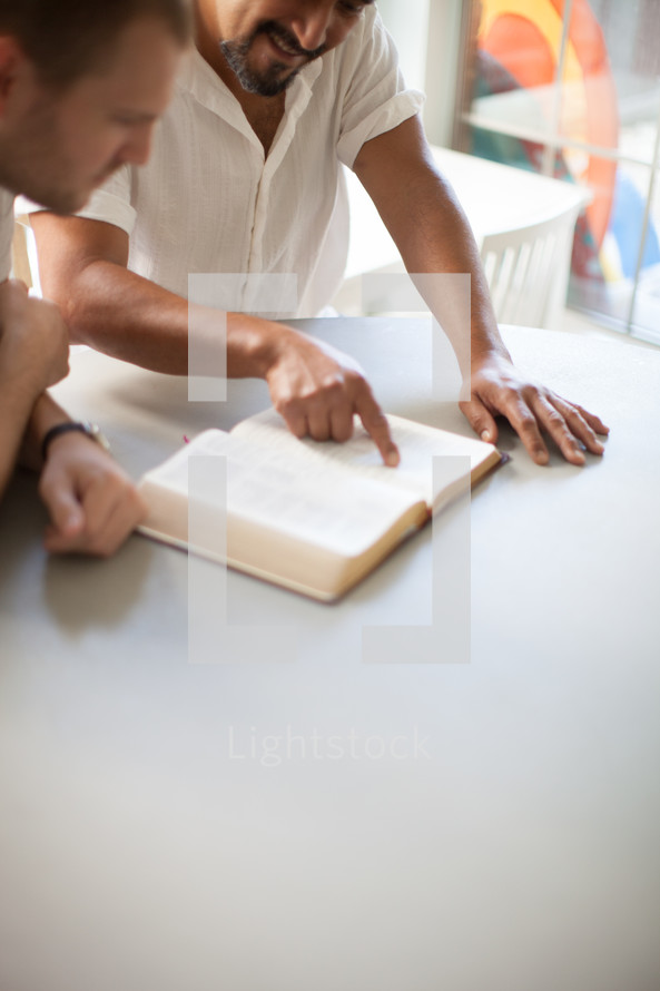 men reading a Bible