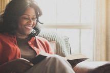 Joyful woman reading the Bible.