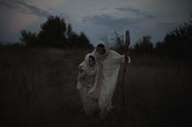 Mary and Joseph walking