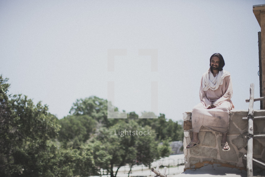 Jesus sitting on a roof
