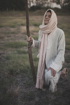 shepherd kneeling in prayer