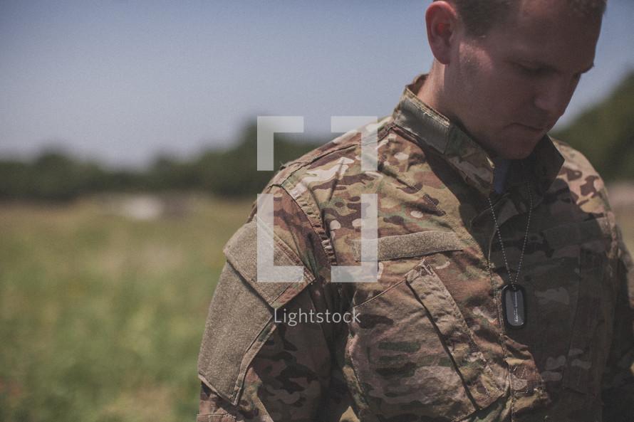 serviceman in prayer