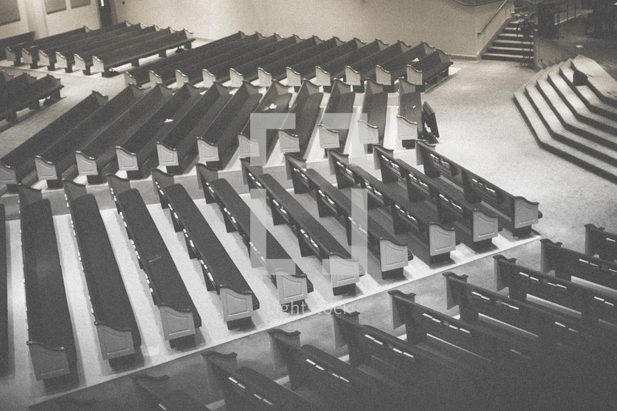 Rows of empty pews.