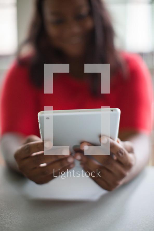 woman looking at an iPad screen