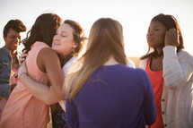 women hugging in fellowship