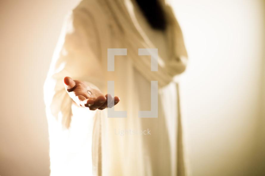 Jesus extending His hand.