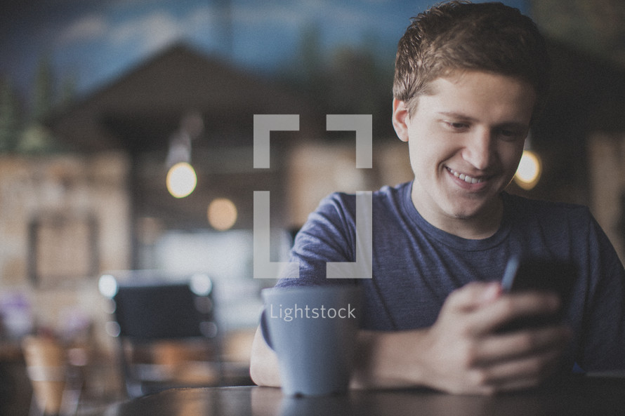 man checking his cellphone