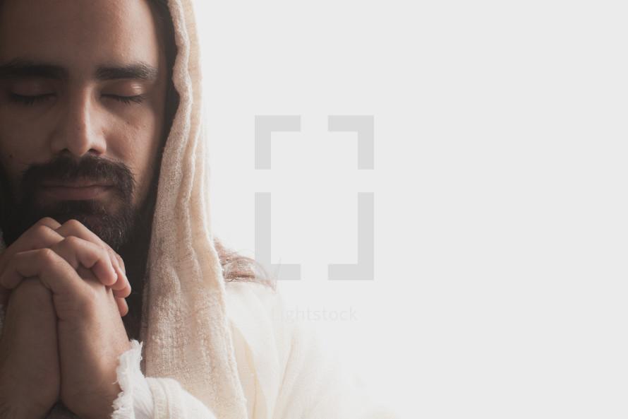 The resurrected Christ -- Jesus praying.