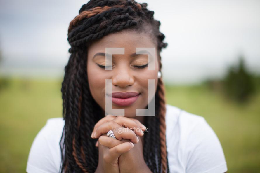 African-American woman in reverent prayer