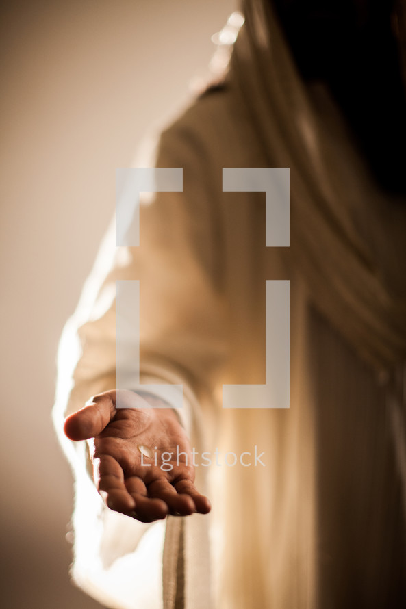 The resurrected Christ -- Jesus extending His hand with an invitation to follow Him.