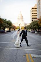 Bride and groom walking across street