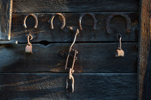 Horse shoes on a barn wall