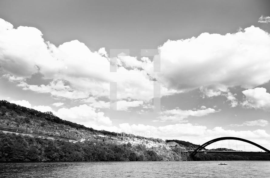 A bridge stretches across a river.