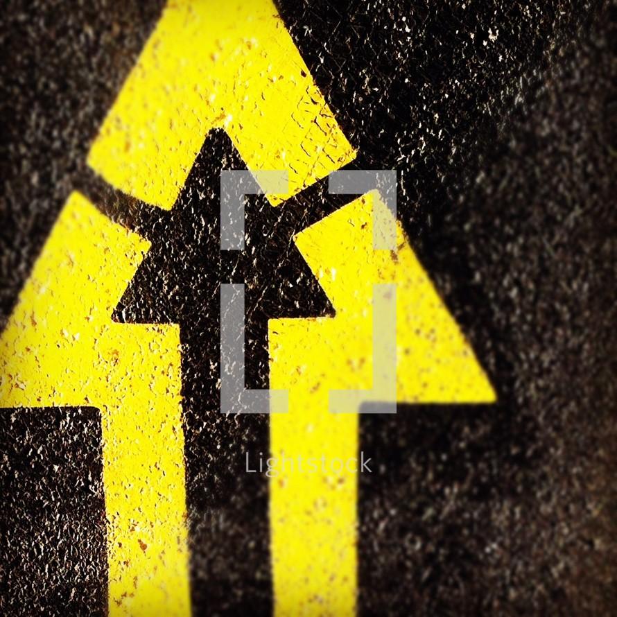Yellow arrow in cement