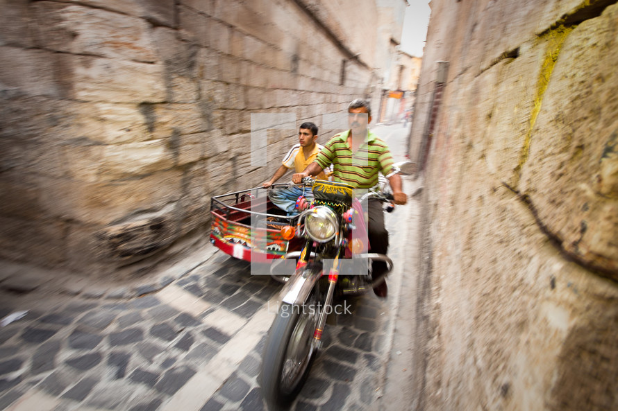 Motorcycle on the narrow streets of old Ottoman district in Shanli Urfa
