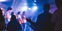 Raising hands in worship