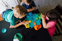 children playing hungry hungry hippos