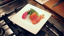 chef preparing a Sushi salmon plate