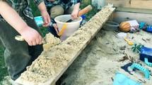 boys playing in a sandbox