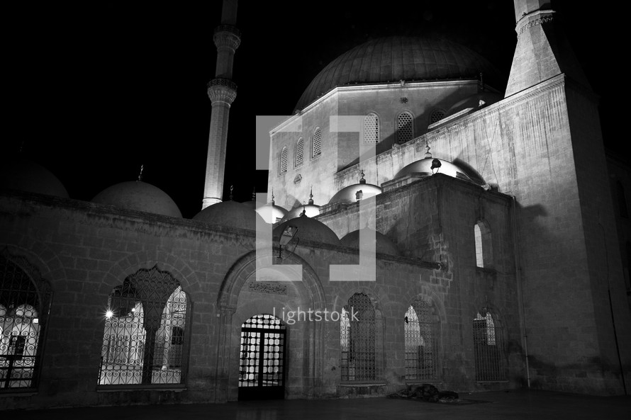 Mosque at night with full moon