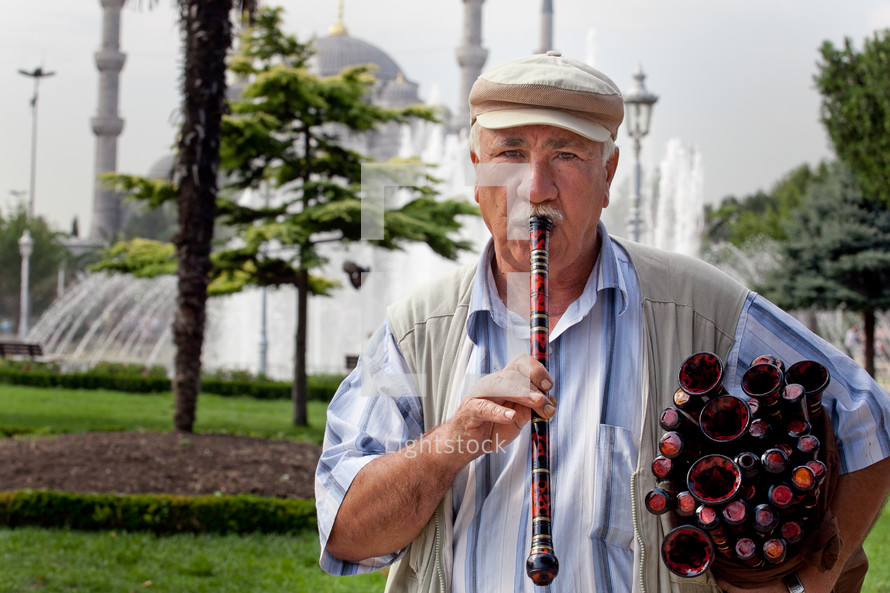Turkish man with flutes